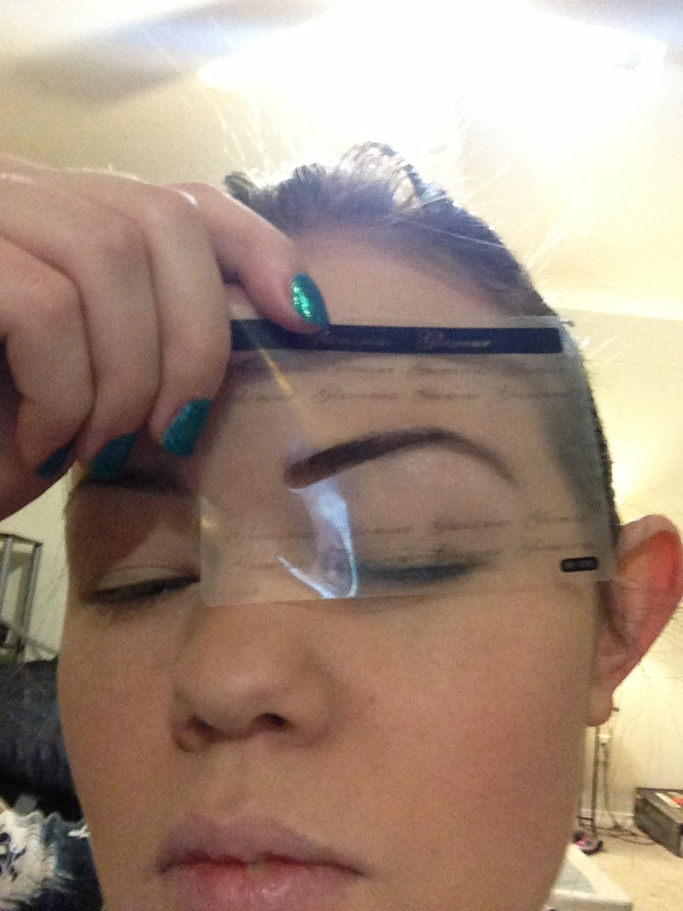 Put stencil over brow and fill with eye shadow.