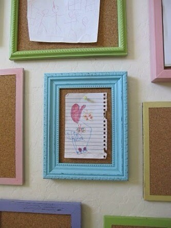 Use different sizes of frames. Take out glass and add a peg board.   Perfect way to show off your child's work..