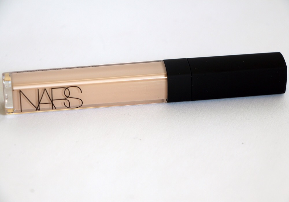Next I'll take this concealer and put it under my eyes in a V shape, any blemishes, and my jaw line.