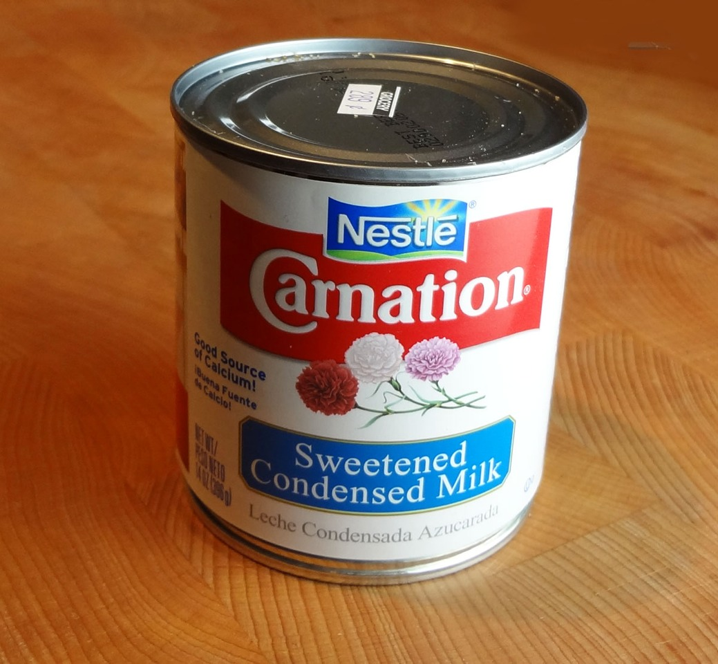 Take your 8-12 oz can of condensed milk and pour it into a medium sized mixing bowl.