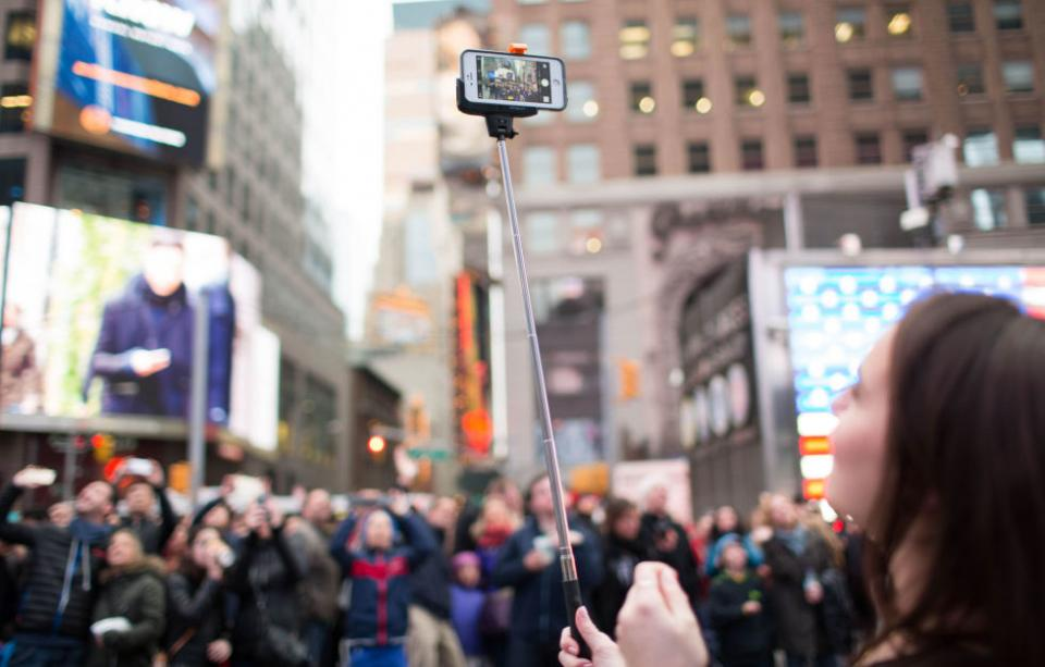 9. If the venue allows selfie sticks (Coachella and Lollapalooza have banned them), use yours to take photos of the stage when you can't see over a crowd of people. No more annoying hands and backs of people's heads ruining your pictures.
