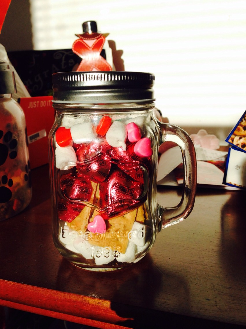 Simple and fun! What you need is a mason jar , Marshmallows, gramcrackers, heart chocolate ( or any chocolate) and heart candy!