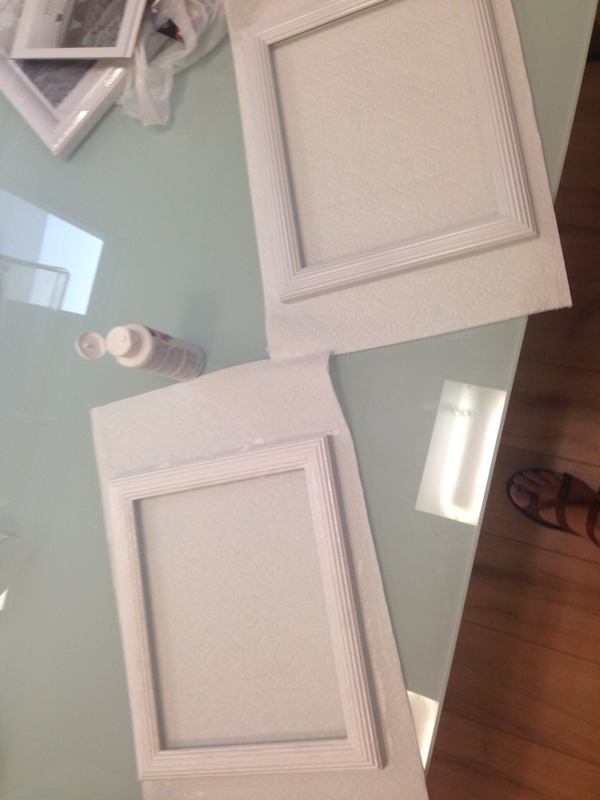 I took this cheap plastic picture frame and painted it with a sponge brush with white acrylic paint to make them look more vintage