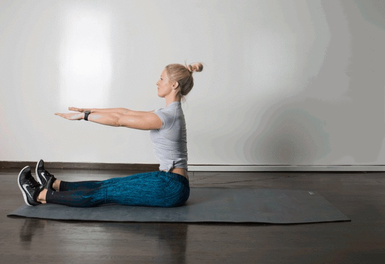 9. Roll Up  Lie faceup, with legs extended, knees together, feet flexed, arms overhead. Take a big inhale. As you exhale, lift arms up and forward, and use your abs to slowly roll up to a sitting position. Squeezing abs again, slowly lower down to starting position.