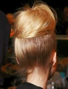 Depending on your hair type and how much you tease your bun you can get a smooth large bun.