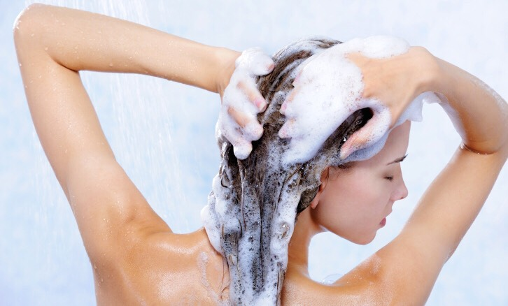 Just wash and condition your hair the way you normally would then lather your hair in coconut oil. Let it sit for a few minutes then rinse. You may have to shampoo again to remove excess oil.