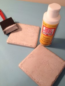Step 2: Spread some Mod Podge onto the tile.