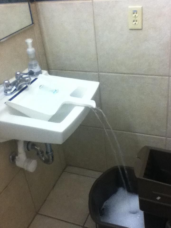 Use a clean dustpan to fill a container that wont fit in the sink