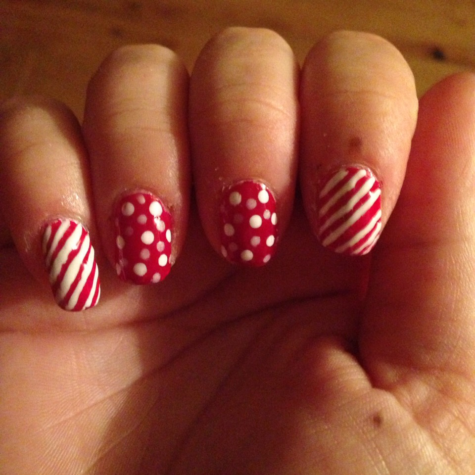 Candy cane inspired nails with dot nails being red with white and silver dots