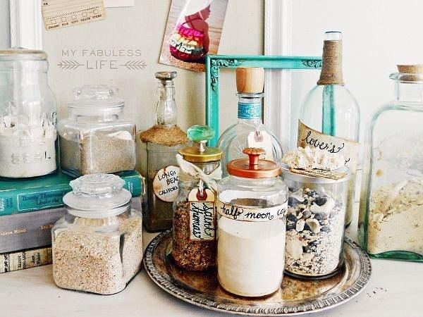 Memory Bottles Add sand and seashells from special places to make My Fabuless Life's inspired memory bottles. Wine bottles combined with jars of any shape and size make an arresting array.