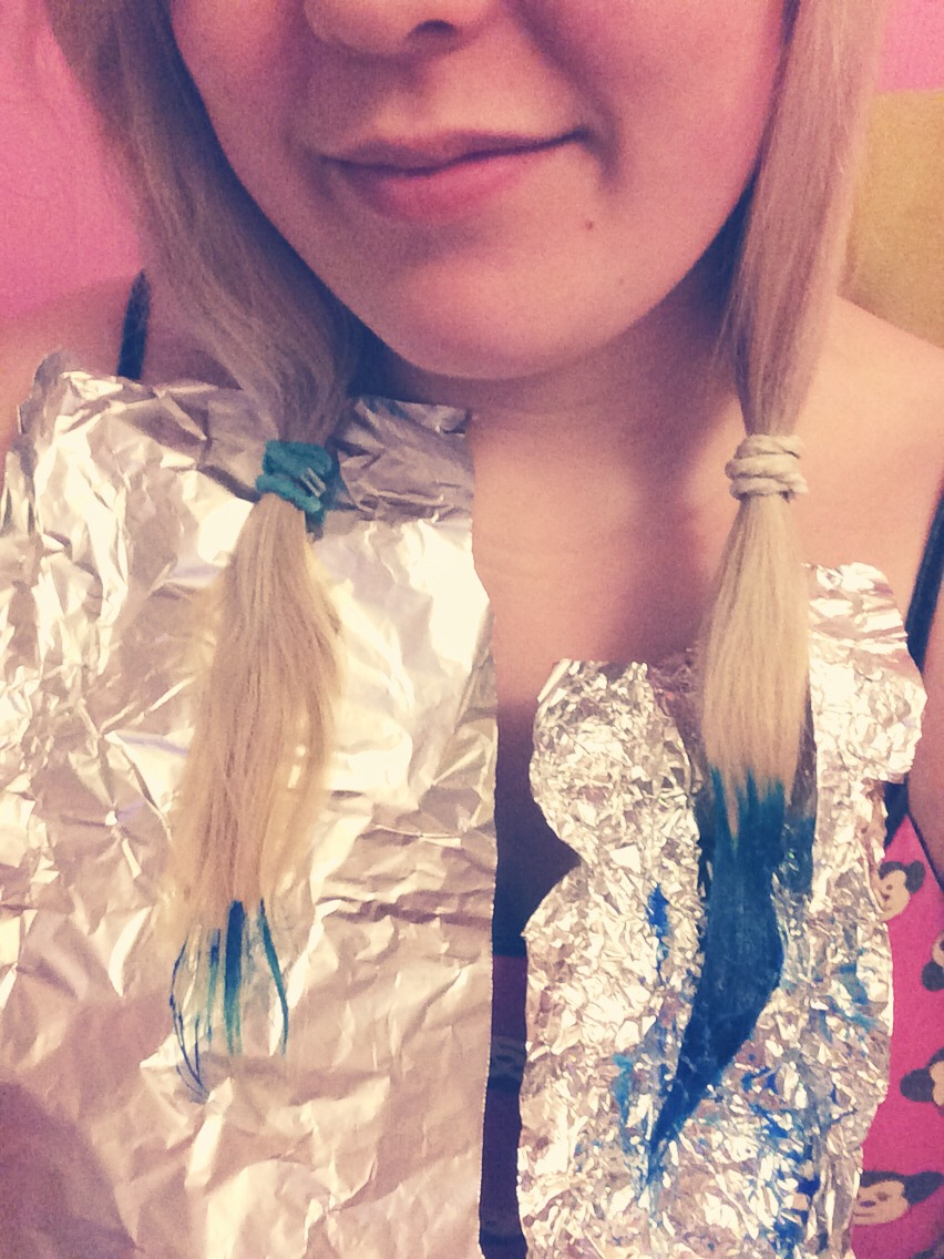 Use the foil to rest your hair on and paint on your dye with your paintbrush making sure you get all the hairs by flipping the pony tail over to get to the other side easier.