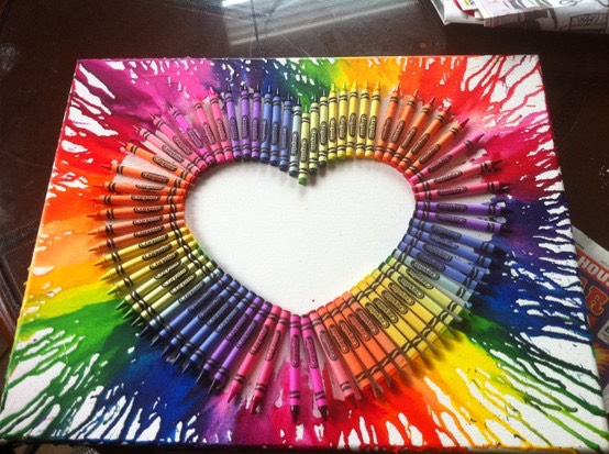 You can also try creative shapes like this heart. You will have to blow dry one side at a time and then let it dry. Then turn the canvas for the other side in order for it to drip the correct way.