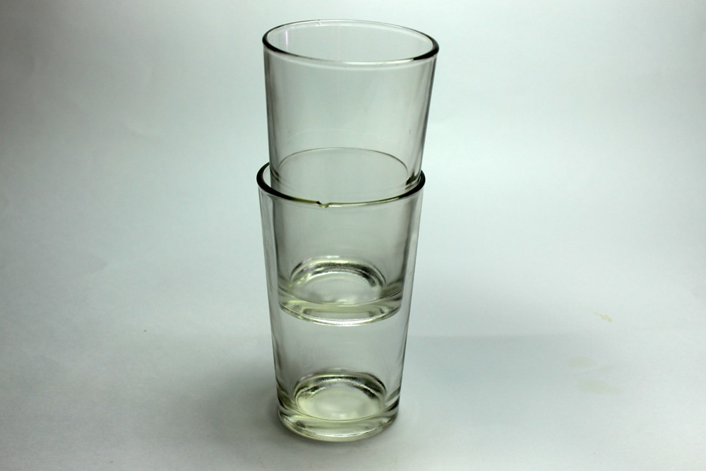 Place cold water in the top glass and dip the bottom glass in hot water the top one will slightly shrink and the bottom will expand!!!!