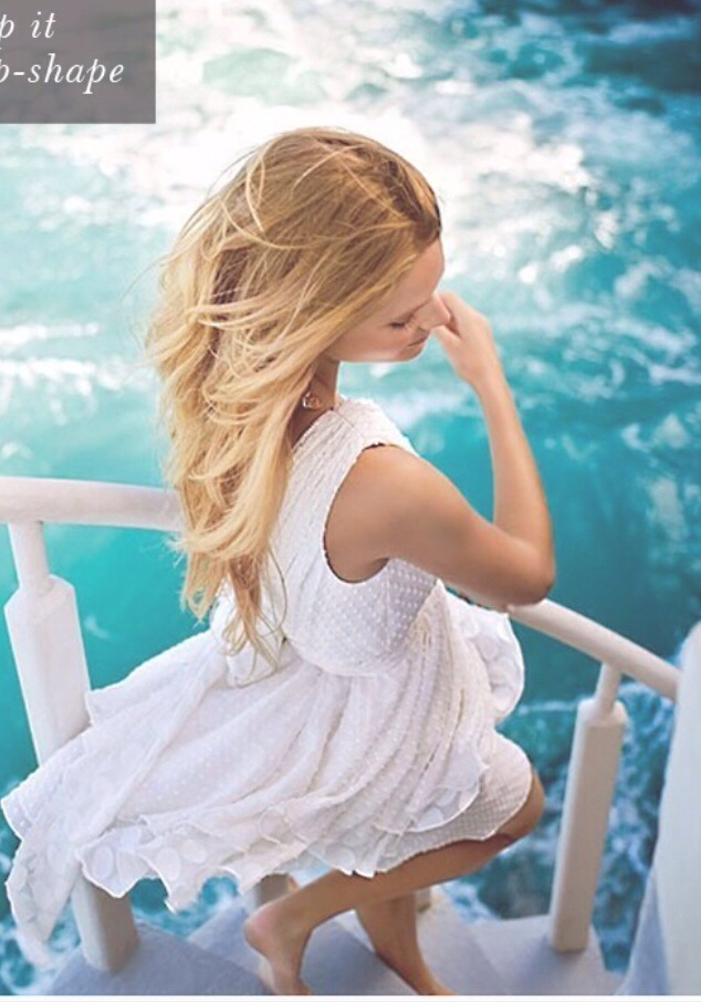 Before you hit the water, step in the shower and get your hair wet, squeeze out the excess water, and put deep conditioner throughout the hair. Don't rinse it out! It will block the salt and chlorine from getting to your hair