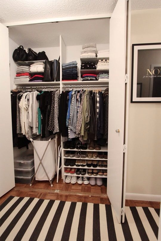 9. Use vertical space (both above and below the closet rod) to store more.