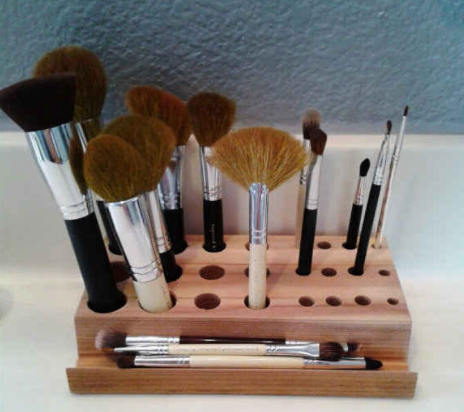 Makeup brush organizer. Even with a space for double-ended brushes. ($15)  https://www.etsy.com/listing/221688110/makeup-brush-organizer?ga_order=most_relevant&ga_search_type=all&ga_view_type=gallery&ga_search_query=makeup%20brush%20organizer&ref=sr_gallery_1