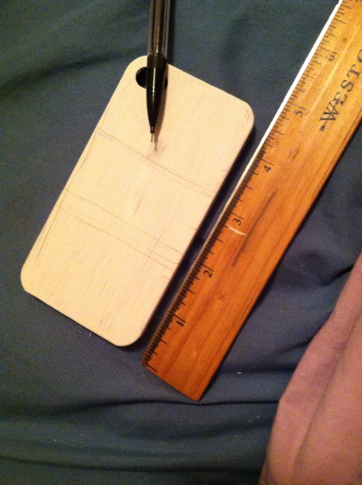 After the white paint is dry, either use painters tape or a pencil and ruler to divide the case into 3 sections.