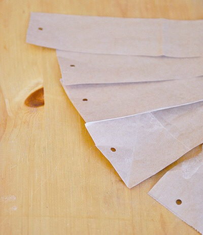 Cut your paper bag into strips that are 2 – 3 inches wide (no need to measure…just eyeball it).