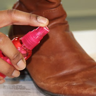 water and shoe polish mixture Derek's shoe repair  apply boot polish or  damaging white salt marks should be rinsed off immediately with a 50/50 mixture of white distilled vinegar and water.