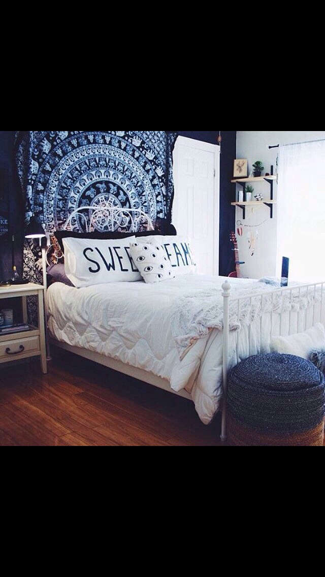 One thing you can do to take yourwalls up a notch is to hang a tapestry, they are very cute and really catchthe eye. it looks really nice behind the bed.