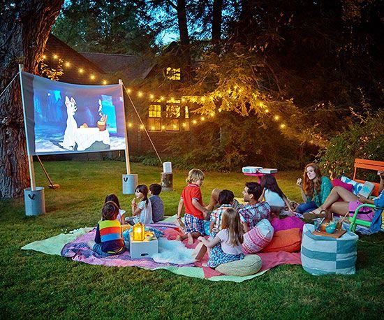 have a backyard movie night as a family with popcorn and your favorite drinks
