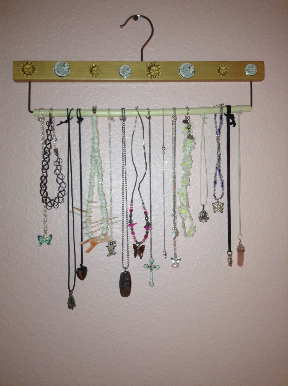 Hang your necklaces on a hanger on the wall