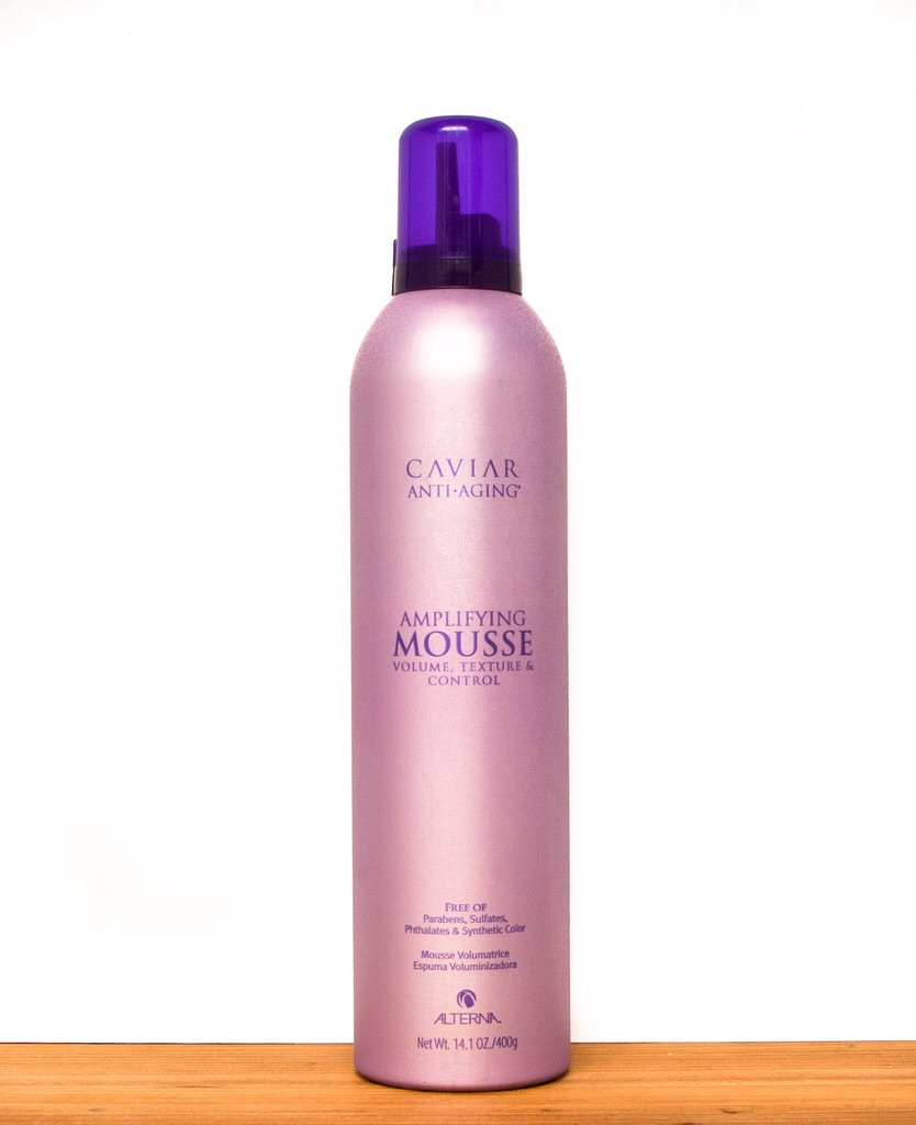 """Use mousse on damp hair, such as Alterna Hair Care Caviar Anti-Aging Amplifying Mousse, to add movement and body without stiffness or stickiness, then elongate your frame by pulling hair back and away from your face. """"When the hair is pulled back behind the jawline a women looks lean and effortless."""