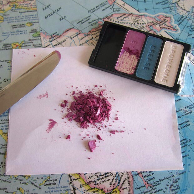 Use a butter knife to scrape the eyeshadow from the compact and onto a piece of paper. Then chop the eyeshadow up - you don't want any big clumps, because those will be trickier to mix into the polish.
