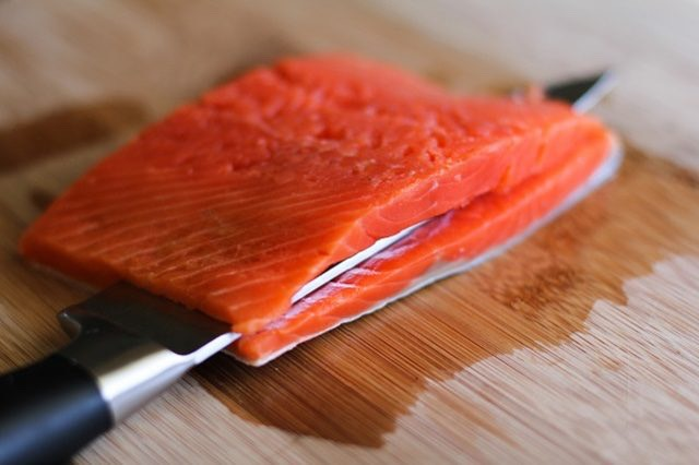 Step 7. Prepare the Salmon  Place salmon fillets (or fillet) on a cutting board. Use a sharp knife to carefully slice the salmon through the center, just until the knife almost reaches the other side.