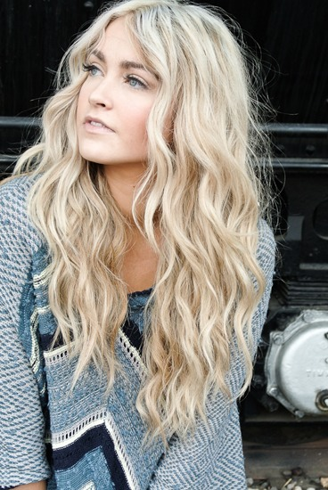 Take your hair out of the braid(s) and spray your hair with hairspray to keep the waves in longer.