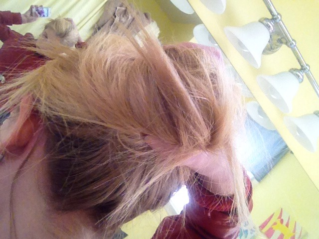 Take your ponytail and wrap it in a circular formation at your head. Use your last two hair ties to secure it.
