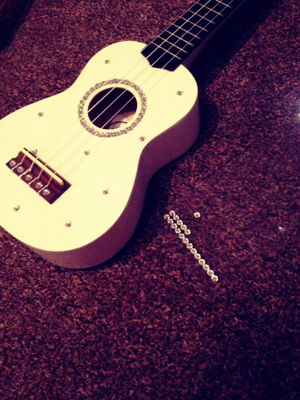 Grab a strip from your local craft shop and stick them onto your Ukulele anywhere you want