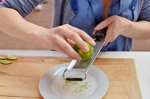9. Zest lime into a plate of sugar.