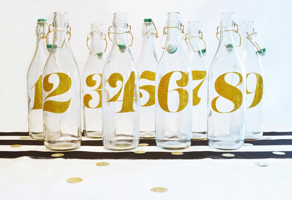 We've created a series of wedding-themed #DIYs, and the first is a set of table numbers that double as water bottles.