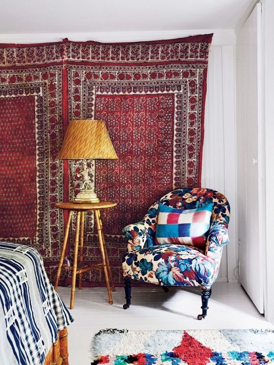Hang a tapestry on the wall for a bit of bohemian flair, as seen onT Magazine.