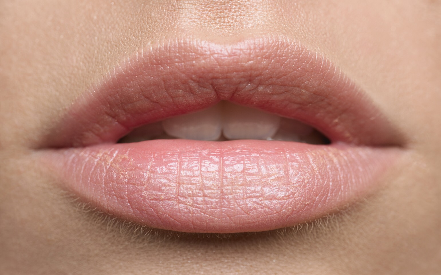 3. Add a clear lipgloss with shimmer to the center of your lips, this will make them appear bigger!