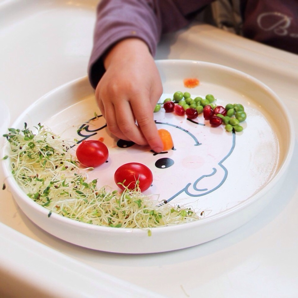 Decorate your plates with a smiley face and let your children do the rest.  Give the character silly hair. Works well with spaghetti ( but very messy )  Beans are another one.