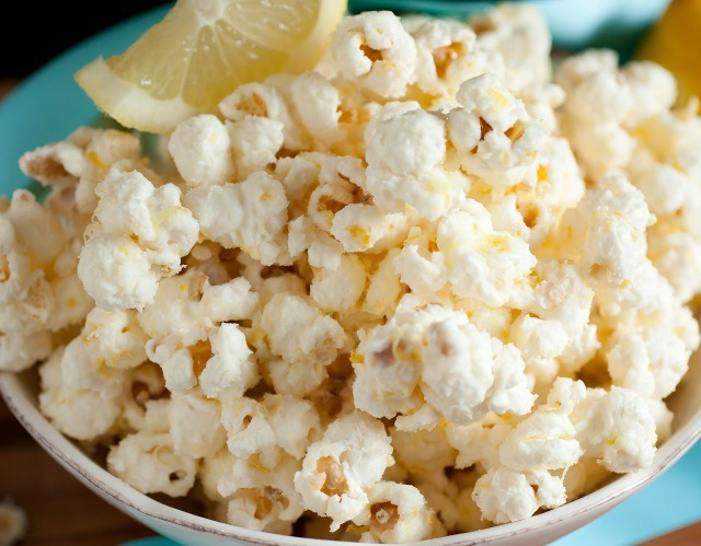 Preheat oven to 275 degrees. Allow coated popcorn to dry at room temperature, about 10-15 minutes, then drizzle lemon juice over popcorn and toss well to evenly coat. Spread popcorn onto a rimmed cookie sheet and bake in preheated oven for 15 - 20 minutes until lightly golden.