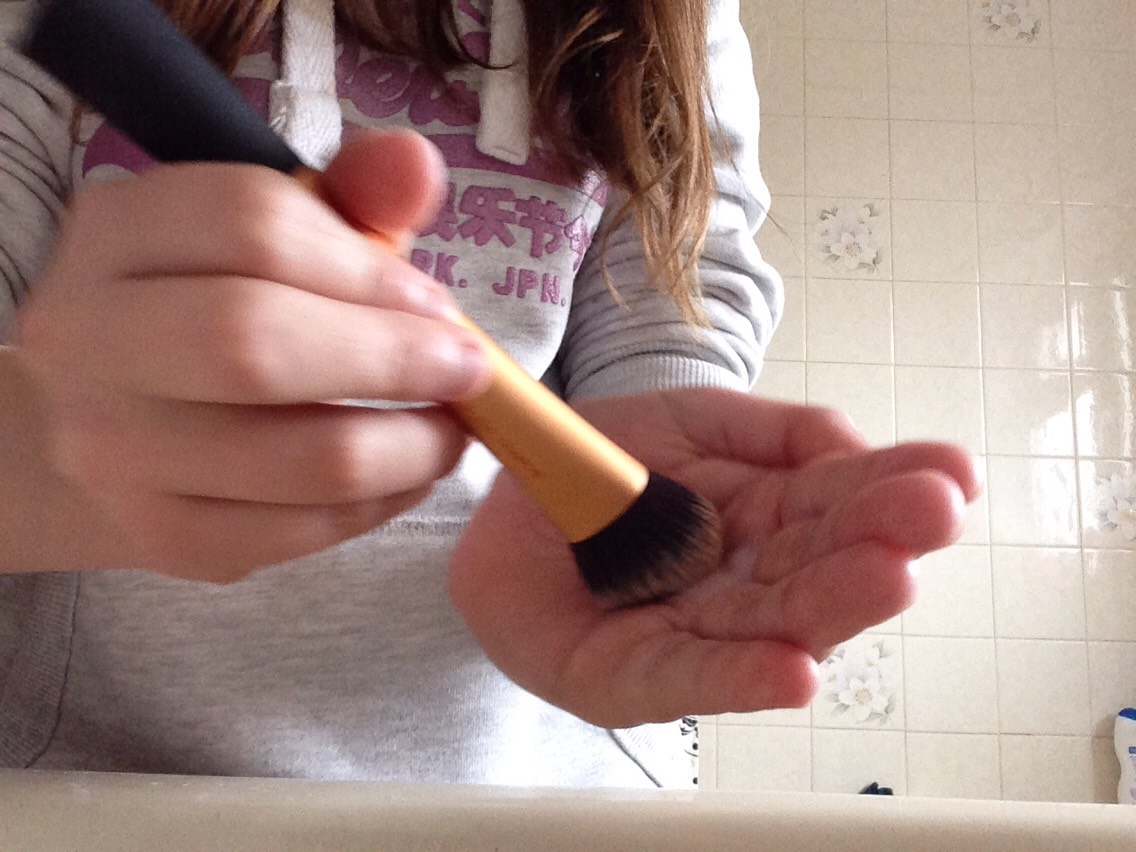 Dip your brush into the water then swirl the brush in your hand then the magic happens