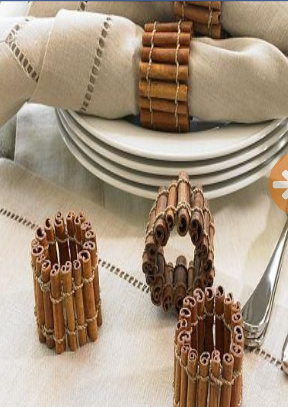 Cinnamon stick napkin holders add an earthy feel to a dinner table (and an earthy scent!)