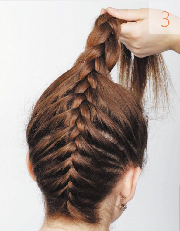 When you reach the crown area start making a simple braid from looses hair. Tie the end of the braid with a band. Arrange the braid as a bun at the crown area of the head. Keep in mind: the band shouldn't be visible. Secure the bun with hairpins in several spots