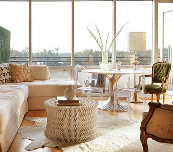 Light and Airy You can pack a lot into your living room—even a dining set—if you keep furnishings from weighing the space down. Lucite dining chairs, an open-weave coffee table, and an unobstructed wall of windows keeps this room from feeling cramped.