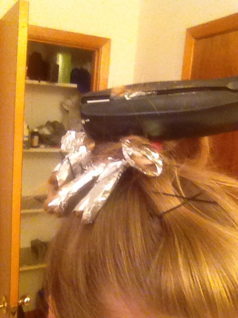 After you have done that you are going to hold your straightener over the tin foil for 10-20 seconds.