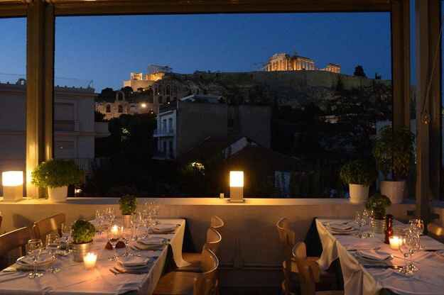 Strofi in Athens, Greece. Dine with the view of the Parthenon next to you.