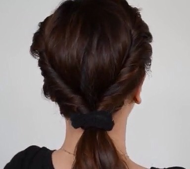 Gather the two twists into a ponytail. Secure with a hair band.