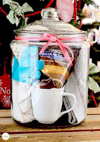 Comfy Cozies In A Jar  This gift in a jar takes the gift of hot cocoa to a whole new level! I'll take your hot cocoa gift and raise you some comfy sweats, soft socks, cozy scarf, toasty warm gloves, and a snuggly hat!☕️