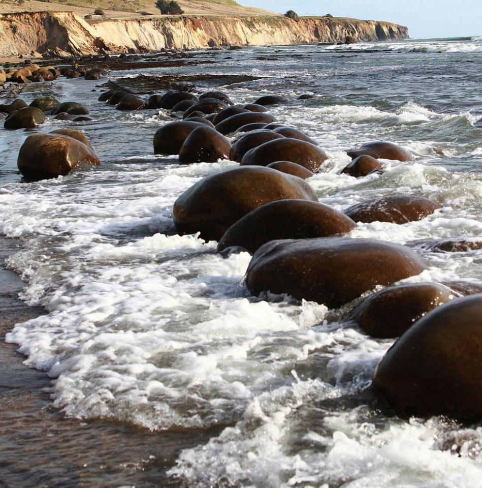 Bowling Ball Beach The name of this beach comes from the spherical rocks scattered across the shore, in Schooner Gulch, Mendocino County, California, USA. The rocks have formed by years of erosion.
