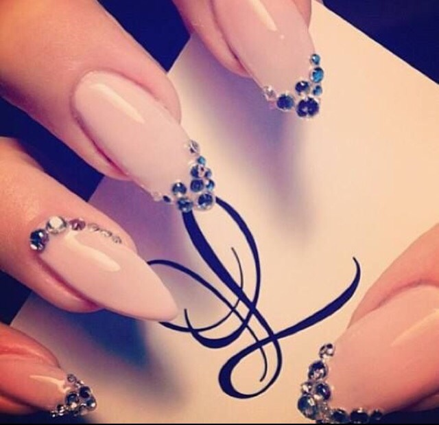 11. SPARKLY STILETTO NAILS