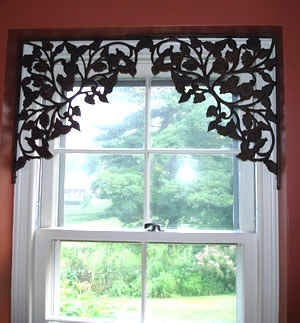 7. Use brackets to decorate a window that doesn't need to be covered up with curtains.