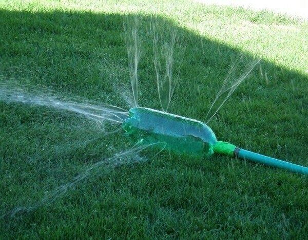 dont want to buy a sprinkler? than make your own! use a pop bottle and poke holes!